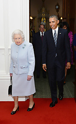 Queen Elizabeth II and the Duke of Edinburgh (rear centre) enter the Oak Room at Windsor Castle, with the President and First Lady of the United States Barack Obama and his wife Michelle, ahead of a private lunch hosted by the Queen.