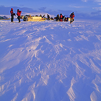 BAFFIN ISLAND, NUNAVUT, CANADA.  Expedition stops to repair snowmobiles on Remote Peninsula, between Sam Ford Fjord and Stewart Valley.