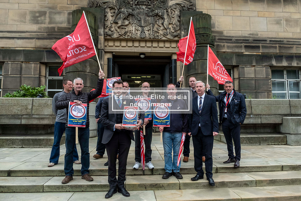 Pictured: Paul Sweeney, Labour and Co-operative MP for Glasgow North East, MSP James Kelly and engineering workers from St Rollox works (Caledonian Works)<br /><br />Paul Sweeney, Labour and Co-operative MP for Glasgow North East, was joined by MSP James Kelly and engineering workers as he handed in a petition at St Andrews House in Edinburgh today highlighting the final scheduled week of work at the St Rollox railway engineering works in Springburn which demands action to prevent the unnecessary loss of 200 skilled jobs in his constituency.<br /><br />Ger Harley   EEm 23 July 2019