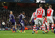 Arsenal's Alexis Sanchez scoring his sides second goal<br /> <br /> - Champions League Group D - Arsenal vs Anderlecht- Emirates Stadium - London - England - 4th November 2014  - Picture David Klein/Sportimage