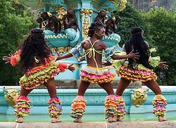 Edinburgh, Scotland, UK; 1 August, 2018. Caribbean Dynasty dance troupe perform at photocall beside Ross Fountain in Princes Street Gardens as part of the Edinburgh Fringe Festival