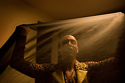 Mosbah, a male belly dancer, prepares backstage for his performance at the Music Hall, Beirut, Lebanon, March 26, 2006.