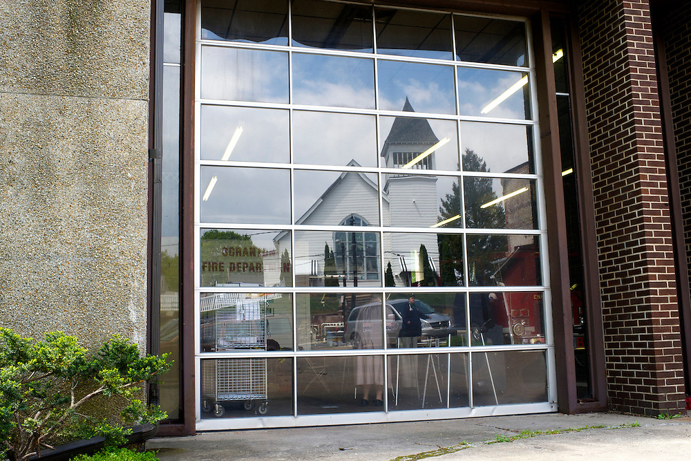 A church is reflected in the glass door of the Scranton Fire Department, a polling station, as Pennsylvania voters cast their ballots on the day of the Republican presidential primary at the in Scranton, Pa., on April 24, 2012.
