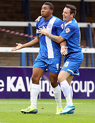 Peterborough United's Britt Assombalonga celebrates with Peterborough United's Lee Tomlin- Photo mandatory by-line: Joe Dent/JMP - Tel: Mobile: 07966 386802 21/09/2013 - SPORT - FOOTBALL - London Road Stadium - Peterborough - Peterborough United V MK Dons - Sky Bet League 1