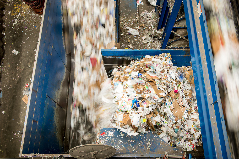 Overlapping streams of paper recyclables.
