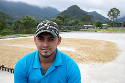 """Mario Roberto Fernández, coffee farmer with Montaña Verde coffee cooperative, San Luis Planes, Santa Barbara, Honduras. """"The damages we've had here from the two hurricanes, on top of the pandemic, we've seen damages to housing, roads and farms. There's a combination of problems together. We are very worried, because we can't see how we'll get through the year and deliver coffee to our clients, even to get the coffee out of the area. We've had losses, we've done some analysis in the coop, we've completely lost 40 manzanas, the loss of houses. The damage to coffee includes a lot of coffee that dropped while it was green, leaf loss that stops the growth of the coffee beans, and that lowers production and quality, and then we are already suffering from fungal diseases on the farms: anthracnose, coffee tree leaf rust, American coffee leaf spot. Climate change is affecting us in different ways, the rains come when we don't expect them, then don't come when we expect them. On my farm there was a lot of leaf loss and green coffee that dropped. In many cases it won't be worthwhile picking the coffee if the growth is affected and there is damage to the coffee beans. Across the whole coop there will be a big loss, and the economy here will be badly affected."""