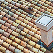 """A rooftop with a chimney and colorful shingles on a building in the old city of Dubrovnik, Croatia. <br /> <br /> Dubrovnik serves as the official setting of """"King's Landing"""" from the popular TV show """"Game of Thrones"""".<br /> <br /> LICENSING: This image can be licensed through SpacesImages. Click on the link below:<br /> <br /> http://tinyurl.com/bnegsab"""