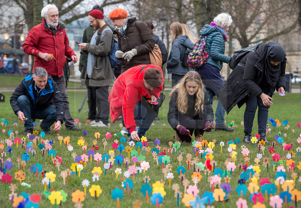 """© Licensed to London News Pictures. 25/01/2020. Bristol, UK. Anyone's Child: Families for Safer Drug Control campaign; """"Take drugs seriously"""" event at Bristol's College Green, planting 'forget-me-not' flowers to remember those who have died as a result of what the campaign says are dangerous drug policies in the UK. The event is in remembrance for the 4000 plus people that die every year in the UK from the effects of drugs. One in three of all drug related deaths in Europe now happen in the UK. Anyone's Child is a campaign by Transform Drug Policy Foundation to end the war on drugs, better protect children, and get drugs under control. Anyone's Child: Families for Safer Drug Control is an international network of families whose lives have been wrecked by current drug laws and are now campaigning to change them. They are now calling for governments to be honest and base drug policy on reality, not fear, which they say means regulating drugs to reduce the risks they pose. Photo credit: Simon Chapman/LNP."""
