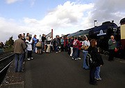 United Kingdom, Kidderminster, 25 October 2009: Railway enthusiasts watch The Tornado arriving at Kidderminster station on the Severn Valley Railway. The Tornado is a Peppercorn class A1 Pacific steam locomotive. Photo by Peter Horrell / http://peterhorrell.com...