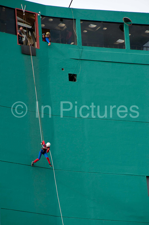 Bolivia June 2013. La Paz. Urban Rush organise for people to descend the 17 floors of the Hotel Presidente wearing a Spiderman costume.