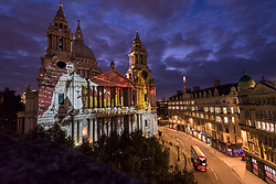 "© Licensed to London News Pictures. 23/10/2019. LONDON, UK.  Preview of ""Where Light Falls"", a cutting-edge light show illuminating the facade of St Paul's Cathedral.  Along with poetry and sound, the show tells the story of the St Paul's Watch who ensured the survival of the Cathedral during the Blitz during the Second World War.  The event is open to the public on the evenings of the 24 to 27 October and is supported by Historic England.  Photo credit: Stephen Chung/LNP"