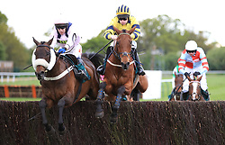 Aerlite Supreme (l)ridden by Tom Scudamore jumps the last fence ahead of Garrahalish to win the Racing UK Now On Talktalk TV Handicap Chase
