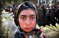 A Kashmiri child waits outside in a cordoned area along with hundreds of other villagers that were evacuated around 4 a.m. March 28, 2002 before a gun battle between a militant and Indian security forces broke out in Budgam district west of Srinagar, the summer capital of Jammu and Kashmir. The muslim militant hid in a mosque in a 20-hour siege. It was the fourth time in two months that separatists had sought refuge in a mosque in the Himalayan region. Nearly a dozen militant groups are fighting New Delhi's rule in Jammu and Kashmir. India accuses Pakistan of arming and training Islamic militants. Pakistan denies the charge and says it only offers moral and diplomatic support to Kashmiri separatists.