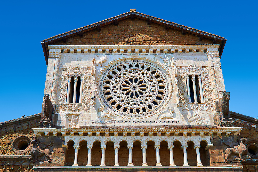 13th century Rose window, sculptures and loggia on the facade of the 8th century Romanesque Basilica church of St Peters, Tuscania, Lazio, Italy .<br /> <br /> Visit our ITALY PHOTO COLLECTION for more   photos of Italy to download or buy as prints https://funkystock.photoshelter.com/gallery-collection/2b-Pictures-Images-of-Italy-Photos-of-Italian-Historic-Landmark-Sites/C0000qxA2zGFjd_k .<br /> <br /> Visit our MEDIEVAL PHOTO COLLECTIONS for more   photos  to download or buy as prints https://funkystock.photoshelter.com/gallery-collection/Medieval-Middle-Ages-Historic-Places-Arcaeological-Sites-Pictures-Images-of/C0000B5ZA54_WD0s