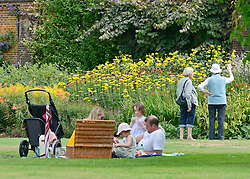 © Licensed to London News Pictures. 14/08/2013. Cliveden, UK People enjoy the warm weather today, 14th August 2013, in the grade 1 listed grounds of Cliveden, a National Trust property in Maidenhead, Buckinghamshire. Photo credit : Stephen Simpson/LNP