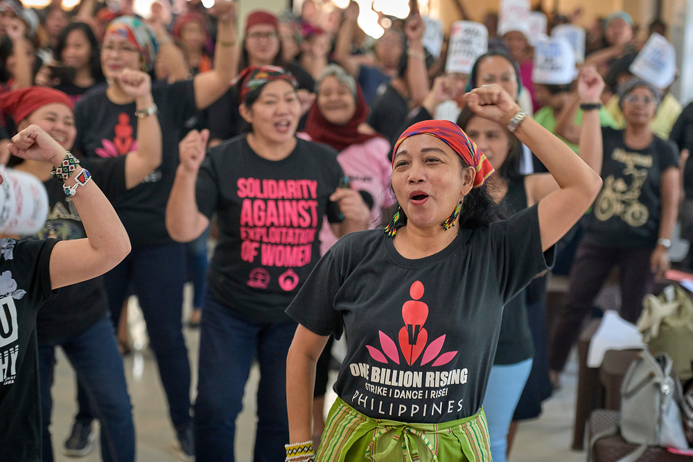 Norma Dollaga leads women in the One Billion Rising song as they participate in a Valentine's Day protest in Manila on February 14, 2019. The demonstrators called for an end to all violence, especially violence against women and the extrajudicial killings of suspected drug users that have plagued the Philippines since the election of President Rodrigo Duterte.<br /> <br /> Dollaga is a United Methodist deaconess and human rights activist.