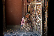 Portrait of Senora taking a rest in the shade of a church porch, in San Miguel de Allende, Mexico.