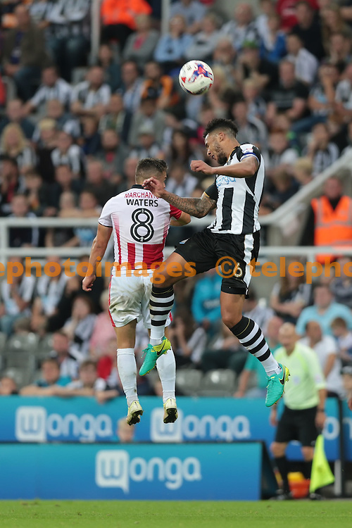 Newcastle United defender Jamaal Lascelles (6) heads clear during the EFL Cup Round Two match between Newcastle United and Cheltenham Town at St. James' Park in Newcastle. August 23, 2016.<br /> Nigel Pitts-Drake / Telephoto Images<br /> +44 7967 642437
