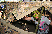 Israeli policeman demonstrates camouflage on a young girl Model Release Available