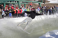 Warwick, NY - A snowboarder crosses the water at the end of a run during the Spring Rally at Mount Peter in Warwick on March 29, 2008.