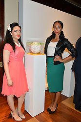 Left to right, singer STEPHANIE McCOURT and athlete JADE JOHNSON at the Art of Futebol - a charity auction of 11 footballs signed by 11 Brazilian legends from Pele to Neymar & decorated and designed by 11 leading contemporary artists in aid of Action for Brazil's Children Trust held at the Brazilian Embassy, 16 Cockspur Street, London on 10th July 2014.
