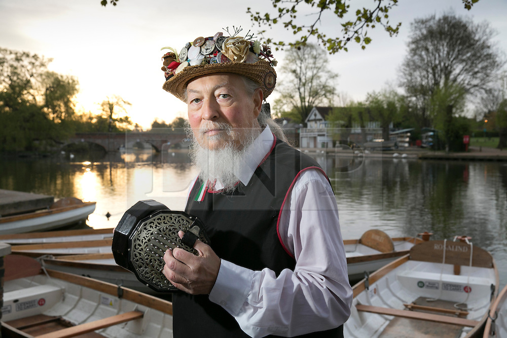 """© Licensed to London News Pictures. 01/05/2015. Stratford upon Avon, Warwickshire, UK. The Shakespeare Morris Men """"Dance in the Dawn"""" on the banks of the River Avon near the centre of Stratford upon Avon on the first day of May. Pictured, Alan Whitbread with his original English Concertina. Photo credit : Dave Warren/LNP"""