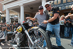 Paul Yaffe with the new owner of his charity auction bike before the start of the Legends Ride from Deadwood during the 75th Annual Sturgis Black Hills Motorcycle Rally.  SD, USA.  August 3, 2015.  Photography ©2015 Michael Lichter.