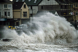 © Licensed to London News Pictures. 21/08/2020. City, UK. Waves crash against the sea wal at Porthcawl at high tide this morning in south Wales as Storm Ellen hits the UK bringing strong winds, especially to coastal areas.. Photo credit: Robert Melen/LNP