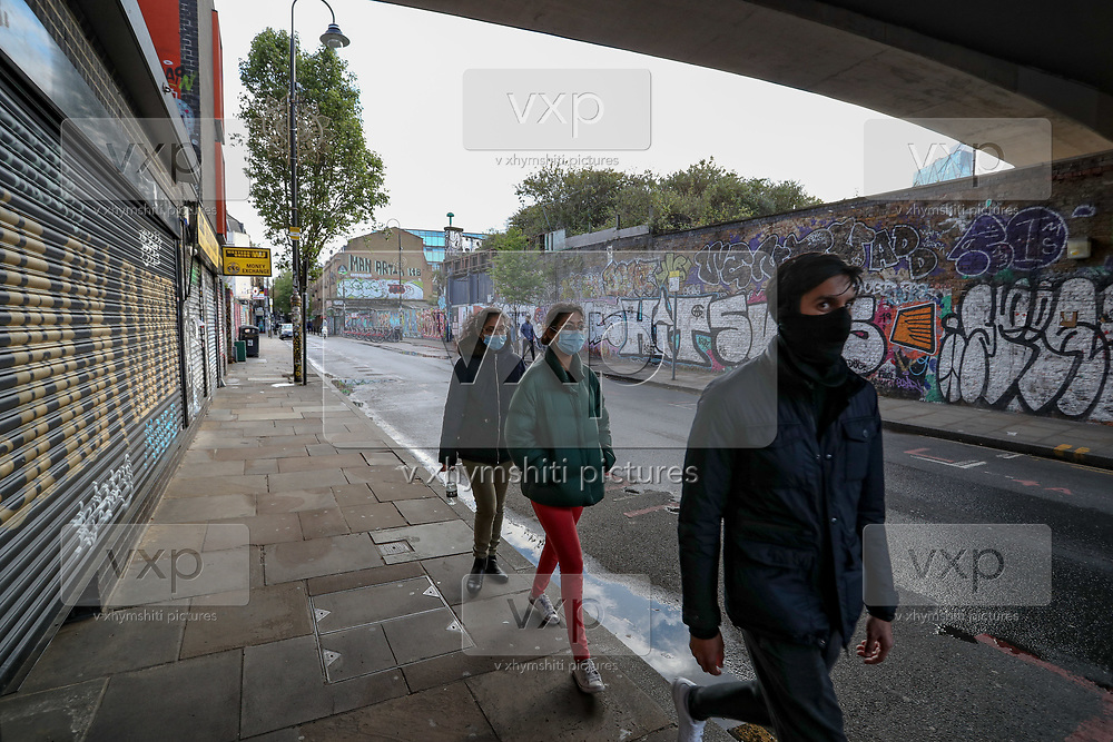 British people observed the 1st of May in various silent ways across the Liverpool Street Station as well as Shoreditch neighbourhoods of London, as the country continues its lockdown to curb the spread of coronavirus, Friday, May 1, 2020. (Photo/Vudi Xhymshiti)