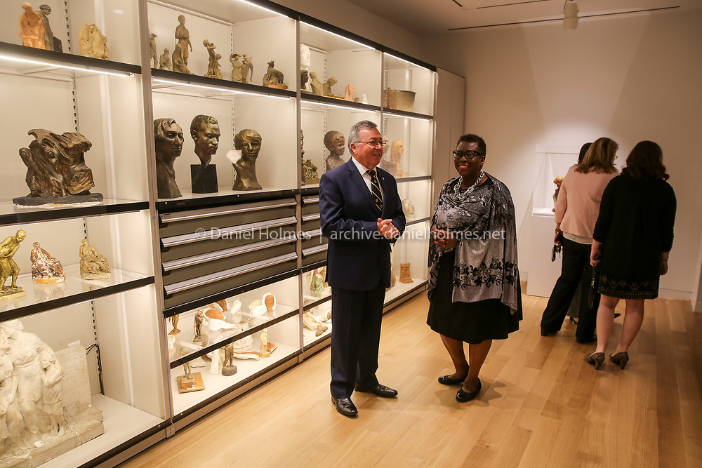 (4/13/19, FRAMINGHAM, MA) Framingham State president Javier Cevallos and Mayor Yvonne Spicer look at one of the galleries during the grand opening of the new Danforth at Framingham State University on Saturday. [Daily News and Wicked Local Photo/Dan Holmes]