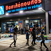 MYTILENE, GREECE - SEPTEMBER 10: Displaced asylum-seekers find themselves camped out in front of a supermarket few kilometers away from the Moria migrant camp as fires, which started Tuesday night, continue to rage into Thursday inside of the camp on September 10, 2020 in Mytilene, Greece. According to UNHCR, current numbers say the asylum-seekers displaced from the encampment are around 12,000. (Photo by Byron Smith/Getty Images)