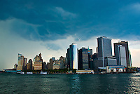 A wide angle photo of the Manhattan skyline shot from the Staten Island Ferry.