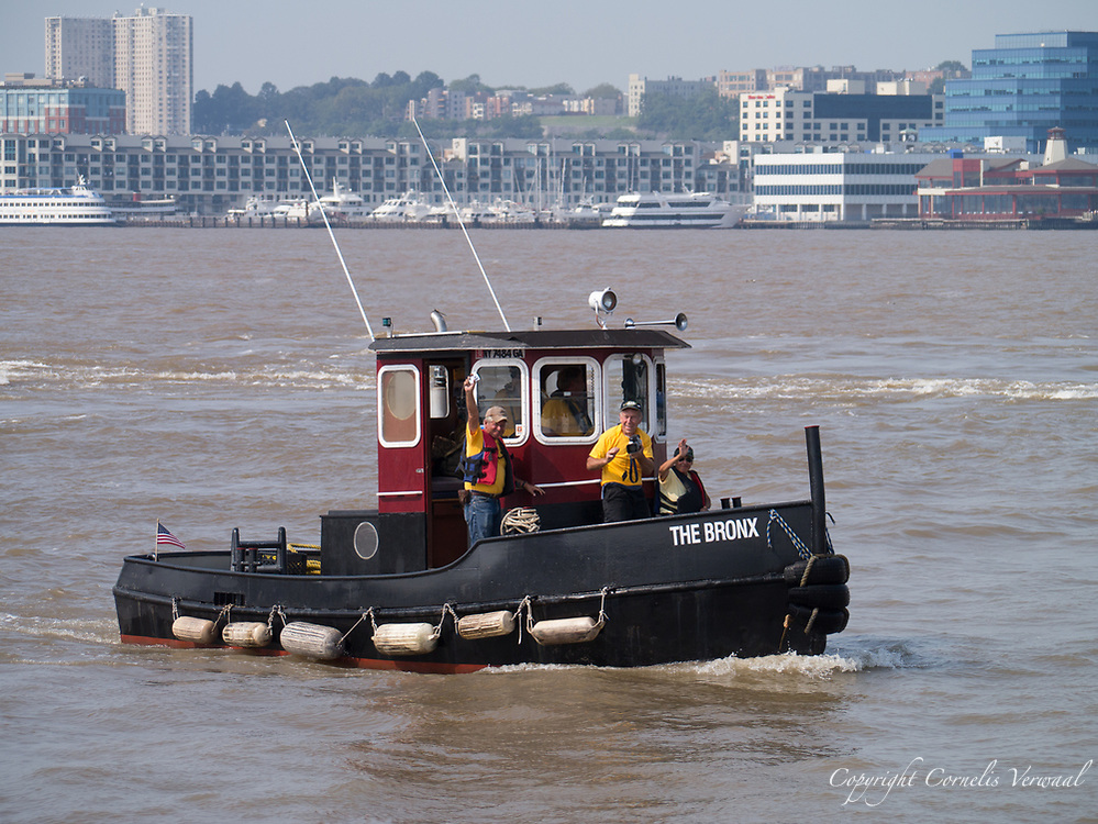 """Although one of New York's smallest tug boats """"The Bronx""""  arrived too late to enter the race, it won """"The Little Toot"""" award for best effort.<br /> The 2011 Great North River Tugboat Race and Competition"""