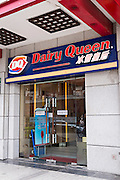 A sign for Dairy Queen ice cream shop in Shanghai, China