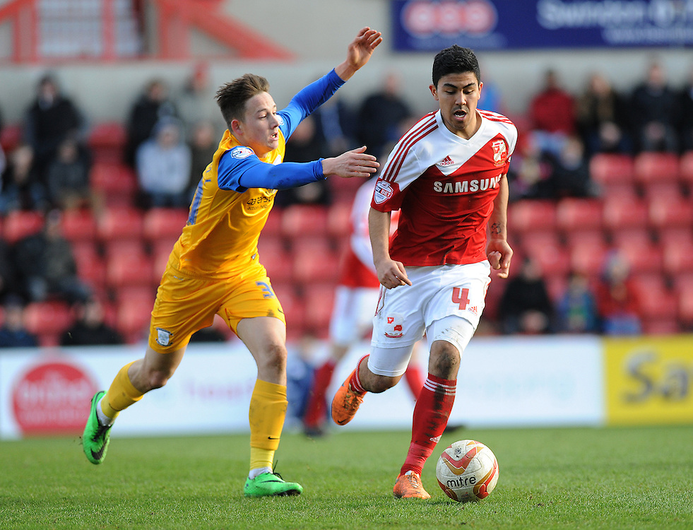 Preston North End's Josh Brownhill vies for possession with Swindon Town's Massimo Luongo<br /> <br /> Photo by Ashley Crowden/CameraSport<br /> <br /> Football - The Football League Sky Bet League One - Swindon Town v Preston North End - Saturday 22nd March 2014 - County Ground - Swindon<br /> <br /> © CameraSport - 43 Linden Ave. Countesthorpe. Leicester. England. LE8 5PG - Tel: +44 (0) 116 277 4147 - admin@camerasport.com - www.camerasport.com