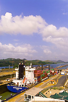 Container ship and tugboat pass through the Miraflores Locks, Panama Canal, Panama