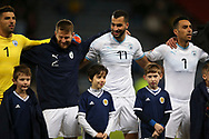 Dor Peretz (11) (Maccabi Tel Aviv)of Israel gives a mascot his top on a freezing night in Scotland for during the UEFA Nations League match between Scotland and Israel at Hampden Park, Glasgow, United Kingdom on 20 November 2018.