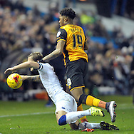 Liam cooper of Leeds United tangles with Chuba Akpom of Hull City during the Sky Bet Championship match at Elland Road, Leeds<br /> Picture by Graham Crowther/Focus Images Ltd +44 7763 140036<br /> 05/12/2015