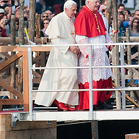 VENICE, ITALY - MAY 08: Pope Benedict XVI (L) walks on a pontoon in St. Mark's basin accompanied by Angelo Scola Patriarch of Venice (R) to board a Gondola on May 8, 2011 in Venice, Italy. Pope Benedict XVI is visiting Venice, some 26 years after predecessor Pope John Paul II last visited city. (Photo by Marco Secchi/Getty Images)