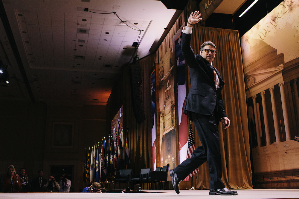 Texas Governor Rick Perrywaves goodbye to the crowd during day two of the Conservative Political Action Conference (CPAC) at the Gaylord National Resort & Convention Center in National Harbor, Md.