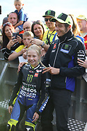 Young Rossi fan meets her hero during the Day of Champions charity auction at the Go Pro British MotoGP at Silverstone, Towcester, United Kingdom on 22 August 2019.