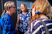 16 JULY 2021 - ALTOONA, IOWA: Congressperson CINDY AXNE (D - IA 3rd District) talks to constituents during the meet and greet after a town hall meeting at the Brick and Ivy Rooftop in Altoona. About 25 people attended the meeting. Axne is the only Democratic Congressperson from Iowa. Axne has not decided yet if she is going to run for reelection in 2022, but three Republicans have already declared their intention to run for the seat. Her set will probably be the most contested congressional seat in Iowa.       PHOTO BY JACK KURTZ