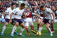 Burnley's Danny Ings is tackled by Everton's James McCarthy. Barclays Premier league match, Burnley v Everton at Turf Moor in Burnley, Lancs on Sunday 26th October 2014.<br /> pic by Chris Stading, Andrew Orchard sports photography.