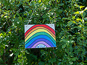 A hand painted sign decorated with a rainbow in support of NHS workers during the Coronavirus pandemic on 14th May 2020 in Silverdale, Lancashire, United Kingdom. The rainbow has become a symbol of gratitude for the NHS during the Covid-19 pandemic. This colourful show of appreciation is a way of uniting a country doing battle with coronavirus.