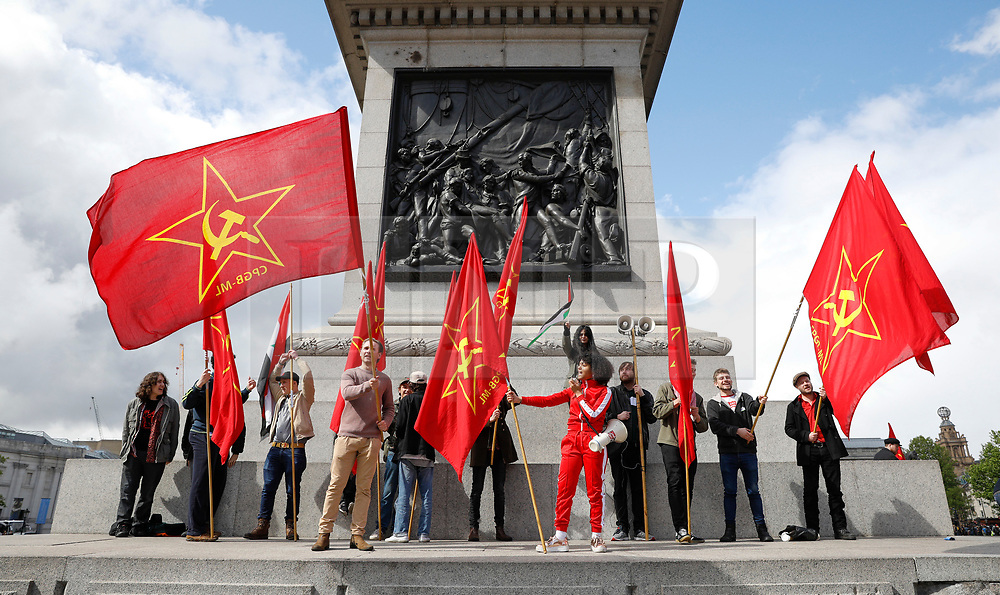 © Licensed to London News Pictures.01/05/2017.London, UK. Communists flags flying at Trafalgar Square in London during a May Day protest march in London on May 1, 2017.Photo credit: Tom Nicholson/LNP