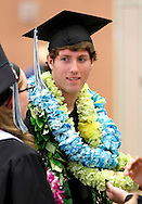 Clint Campbell is covered with leis before Dozier-Libbey Medical High School graduation on Friday, June 8, 2012.  (Photo by Kevin Bartram)