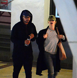 """***PREMIUM EXCLUSIVE. NO WEB UNTIL 4.15 GMT JULY 12 *** These are the exclusive first pictures of Minka Kelly and Jesse Williams stepping out together in public. The rumored new couple were seen leaving a movie theater together in West Hollywood, CA on Friday, July 7. Reports claim the Friday Night Lights star, 37, had been spending time with Williams, 35, since they worked on a video games project together in Paris. An onlooker said: """"The pair were trying to not be noticed and were seen leaving the Sunset 5 movie theatre in West Hollywood. They both had baseball caps and looked dressed down and very low-key. They were seen in a car park after watching the movie The Beguiled."""" Minka dated baseball player Derek Jeter from 2008 to 2011, reuniting again briefly in 2012. Williams is in the midst of a bitter custody battle for his two children, son Maceo, aged one, and daughter Sadie, who is three, pending his divorce from wife Aryn Drake-Lee. He filed the divorce petition in April after fours and half years' marriage, although the couple were together for 13 years, long before his acting career took off. The Grey's Anatomy actor has opened up about the well-publicised divorce in Jay-Z's Footnotes For 4:44 video, in which he makes reference to cheating rumours surrounding his marriage. He says: 'I was in a relationship 13 years, 13 real years, not 5 years, not 7 years, 13 years and all of a sudden mother f***ers are writing think-pieces that I somehow threw a 13-year relationship. Like thee most painful experience I've had in my life like with a person I've loved with all of my heart, that I threw a person and my family in the trash because a girl I work with is cute.' Neither Kelly or Williams has commented on speculation their relationship has transitioned from professional to personal. 07 Jul 2017 Pictured: Minka Kelly, Jesse Williams. Photo credit: MEGA TheMegaAgency.com +1 888 505 6342"""