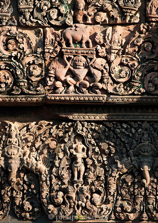 Carvings in the walls of the Hindu temple of Banteay Srei in Angkor, Siem Reap Province, Cambodia