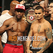 """Floyd Mayweather Jr. (left) poses with Marcos Maidana during the official weigh-ins for the Mayweather versus Maidana boxing match slated as """"The Moment"""", at the MGM Grand hotel on Friday, May 2, 2014 in Las Vegas, Nevada.  (AP Photo/Alex Menendez)"""