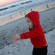 Holly Larue Frizzelle plays on Wrightsville Beach in February 2013. This was the first time Larue visited the beach after completing the 'Induction' phase of chemotherapy.